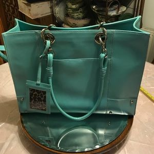 Teal Wilson leather tote bag.